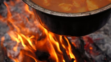 Close up of cooking Hungarian paprika potatoes on a campfire