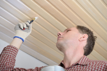Varnishing a wooden ceiling