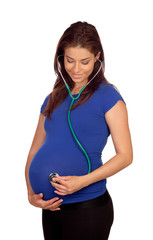 Beautiful pregnant woman with a stethoscope
