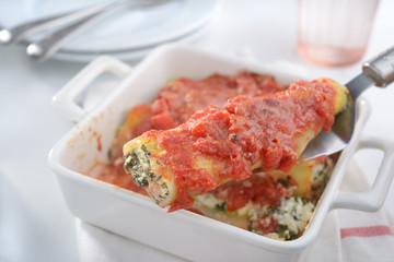 Cannelloni on a cake server