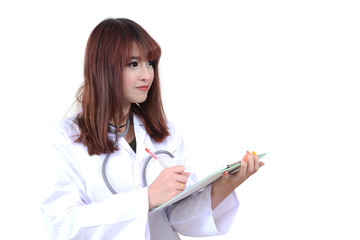 Female doctor in white uniform writing.
