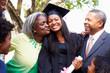 Student Celebrates Graduation With Parents