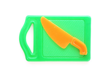 plastic toy green chopping board and orange knife