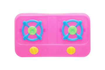 pink plastic gas stove on white background, top view