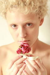 Nudes young woman with dry rose in the hands.