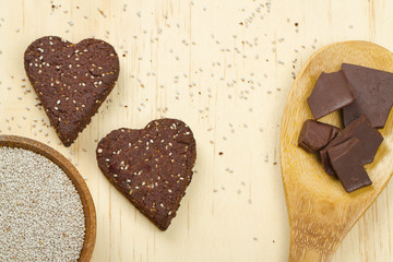 Chocolate chia seed love heart cookies with ingredients