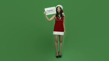 Asian girl sexy santa claus isolated greenscreen green
