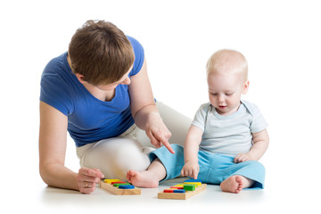 baby and his mom play together with puzzle toys