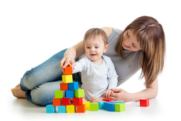 baby boy and mother playing together with  toys