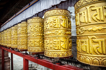 Golden prayer wheels