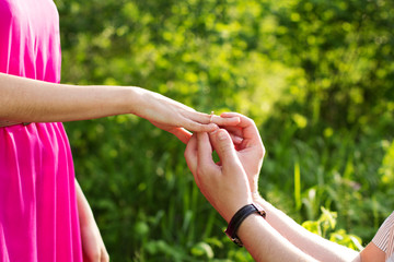 Couple holding hands with ring