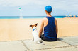 dog and boy at the beach