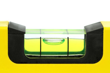 Yellow spirit level , macro image, on white background