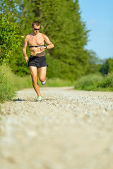 Man running training on country road
