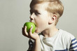 Child eating apple.Little Boy. Health food. Fruits