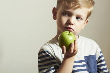 Child holds green apple.Little Boy.Health food. Fruits