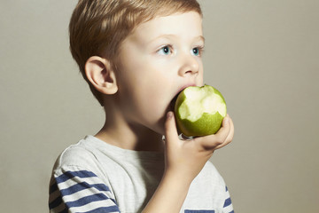 Funny Child eating apple.Little Boy.Fruits. Enjoy Meal