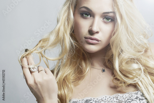 fashion portrait of Beautiful woman.Blond Girl with Curly hair
