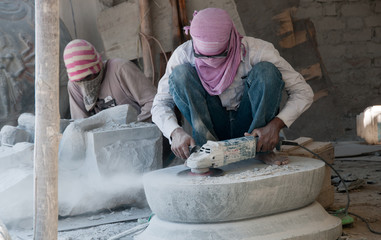 Stone carving workers