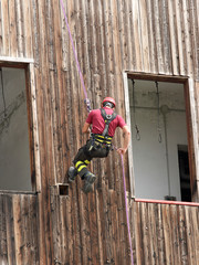 brave fireman climber expert you haul in the wall of the House a