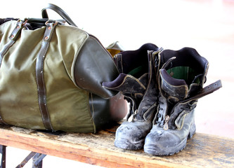 work boots and bag for the transport of clothes after a working