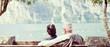 canvas print picture - Älteres Paar sitzt gemütlich am See