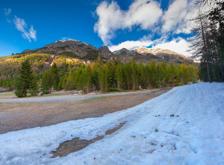 View of the snow cowered Alps peacs in the early spring