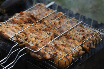 Grilled chicken Leg on the grill