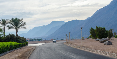 The road in the resort area of Egypt on a background of blue mou