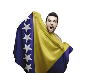 Fan holding the flag of Bosnia and Herzegovina celebrates