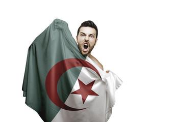 Fan holding the flag of Algeria celebrates on white