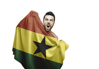Fan holding the flag of Ghana celebrates on white