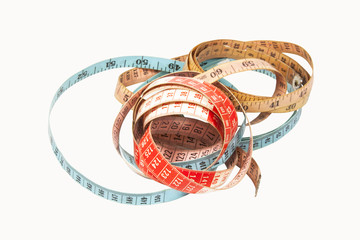 Three Coiled Tape Measures in Blue Red and Yellow