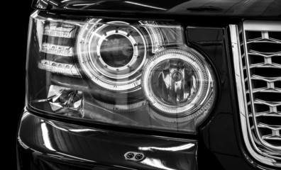 Closeup headlights of car. Car exterior detail.