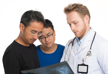 Caucasian doctor showing x-ray to the patient with his friend lo