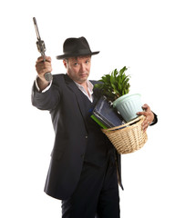 Businessman with gun hold personal belongings