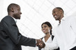 Three african business people handshake - 65593948