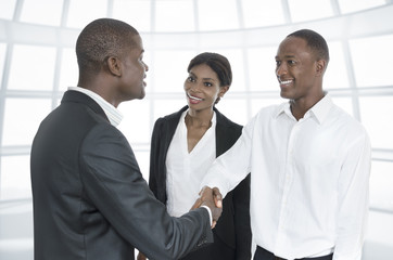 Three african business people handshake