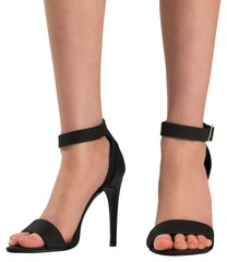 Female feet in black sandals
