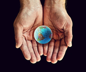 world golf ball in hands
