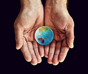 australia golf ball in hands