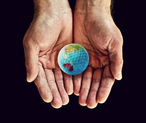australia golf ball in hands
