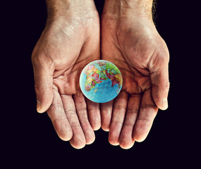 holding world golf ball