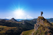 Leinwanddruck Bild - hiker on top of a rock looking far away