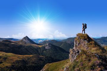 hiker on top of a rock looking far away