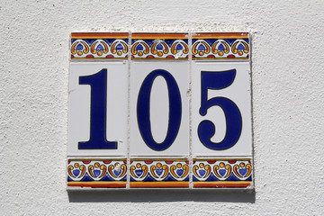 number one hundred and five, house address plate number