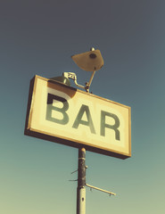 A faded BAR sign on the roadside in Joshua Tree national park.