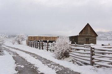 A barn and paddock with fencing in the snow in the Green River Lakes area.