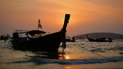 Traditional Thai boats on a sunset, Thailand