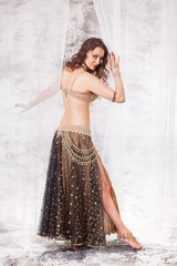 Belly dancer posing on retro set